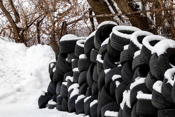 Stacked Tires in the Snow