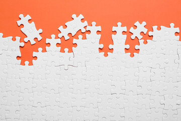 Blank white puzzle pieces on orange background, flat lay
