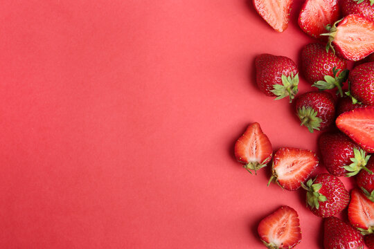 Tasty ripe strawberries on red background, flat lay. Space for text
