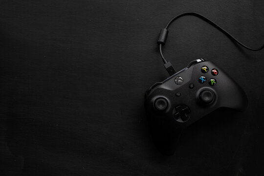 CHIANG RAI, THAILAND-JUNE 19, 2020, top view of microsoft XBOX ONE controller on black wooden floor background. flat lay