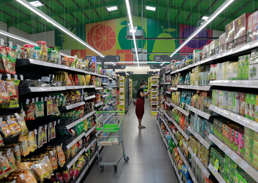 A customer wearing a protective mask is seen while she is shopping at a Keels super market, amid concerns about the spread of the coronavirus disease, in Colombo