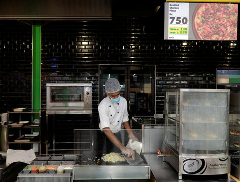 A chef wearing a protective mask cooks at the kitchen at a Keels super market for customers, amid concerns about the spread of the coronavirus disease, in Colombo