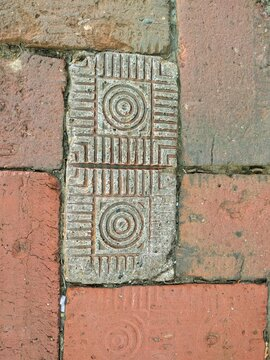 Road paved with patterned antique red bricks