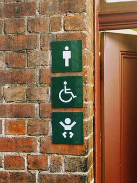 Family-friendly accessible unisex bathroom restroom with signage
