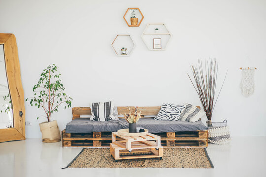 Cozy Living Room. Scandinavian Interior. Living room with pallet sofa and table.