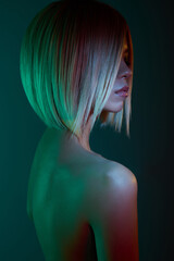 Photo sur Toile womenART Asian woman in neon light. Beautiul blonde in night club