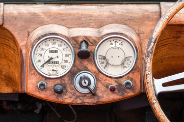 Wall Mural - wooden dashboard and steering wheel interior of a vintage sports car