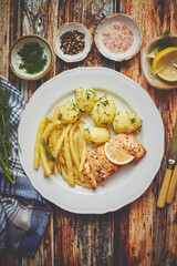 Fresh and tasty baked salmon served with young boiled potatoes and yellow bean.