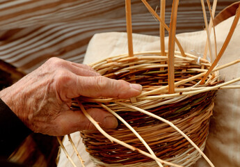craftsman while he creates the wicker basket to sell it to the l
