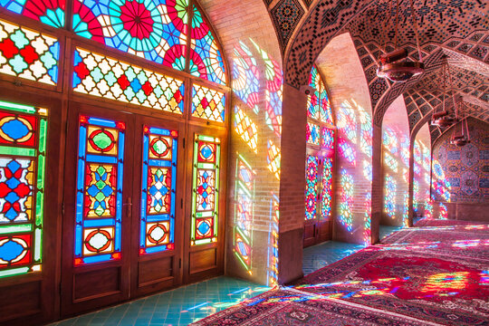 Famous pink mosque decorated with mosaic tiles and religious calligraphic scripts from Persian Islamic Quran, Shiraz, Iran.