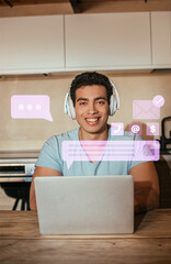smiling bi-racial man listening music in headphones and using laptop near virtual envelope and...