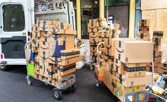 Amazon truck unloading packages from Truck for home delivery in New York City