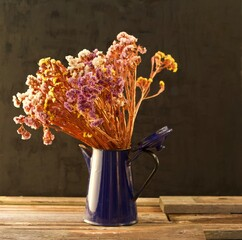 Still life of dried flowers in the evening sun in a barn