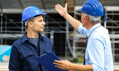 Senior engineer blaming his colleague for delay in construction site