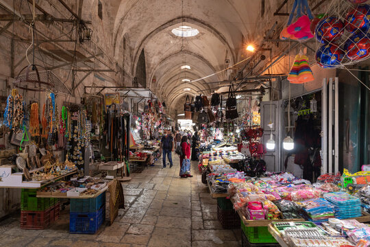 The Arab market with all kinds of souvenirs for tourists and locals on Al-Qattanin street in the Arab Quarter in the old city of Jerusalem, Israel