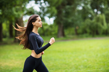 The girl is engaged in morning jogging in the fresh air. Healthy lifestyle concept