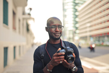 man with digital camera in the city