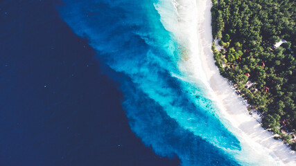 Top view aerial drone photo of stunning colored sea beach with crystalline water. incredibly...