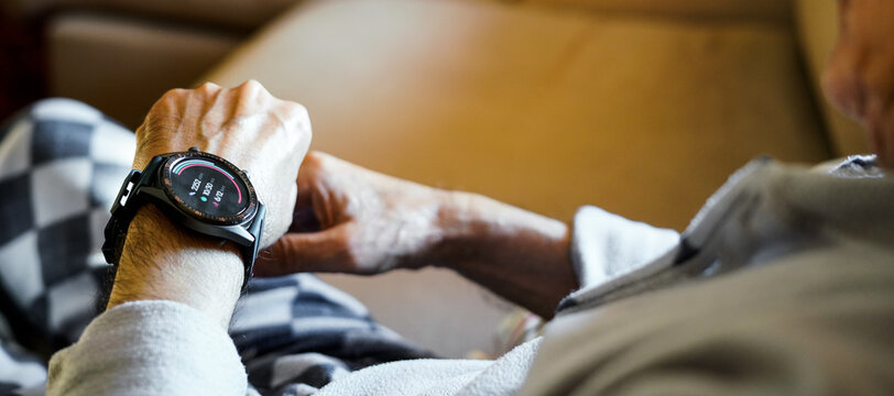 old man checking his condition on his smart watch