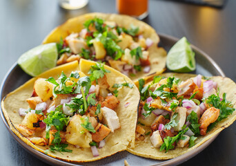 Wall Mural - colorful grilled pineapple and chicken street tacos on plate with lime