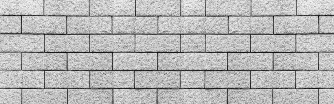 Panorama of Concrete stone block wall texture and background seamless.