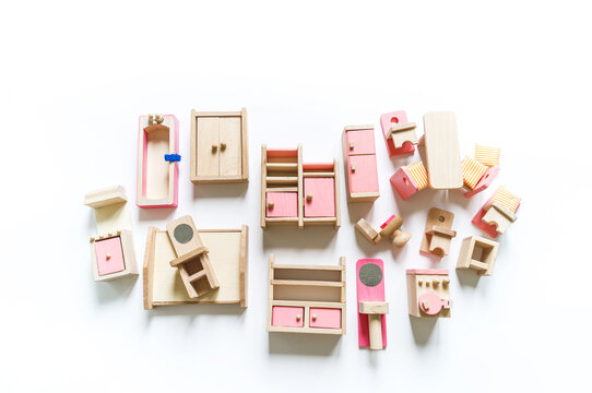 Montessori material. Wooden furniture for the doll house.
