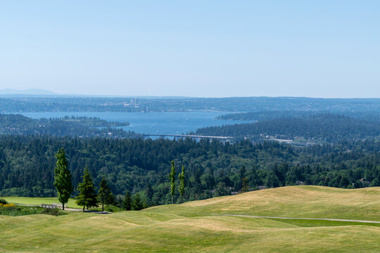 View over Lake Washington towards East Seattle from Newcastle Golf Course on a spring day; highway bridges I-90 and 520 across the lake can be partially seen and the golf course.
