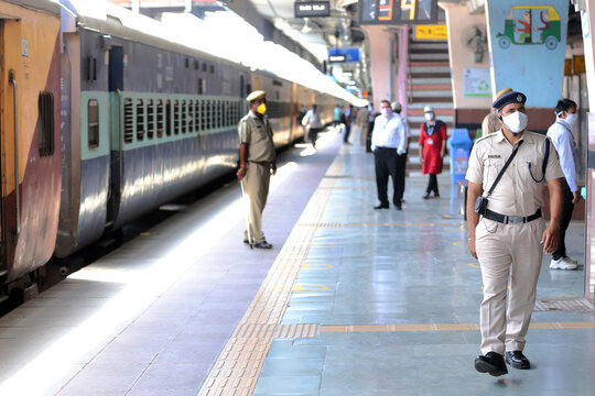 Jaipur,Rajasthan,India_May-2020. Corona warrior cop at work at Jaipur Railway Station,India. Masked cop wearing gadgets of mass communication. Headphone. Cops helping the movement of migrant workers.