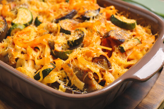 Tasty baked pasta in dish on table, closeup