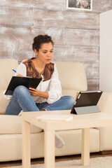Successful freelancer woman working from home during a video call with business partners.