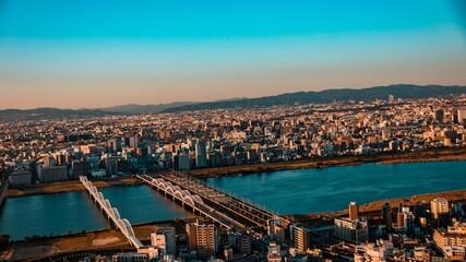 Fototapeta Sunset scenery from rooftop observatory in Osaka