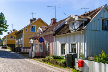 City street with old beautiful small wooden houses