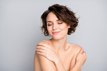 Portrait of positive cheerful pretty girl touch her body have shower enjoy new rejuvenation soft...