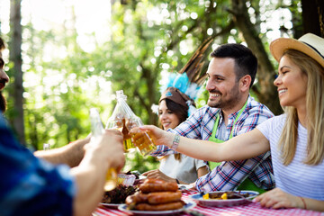 Small group of friends having fun at barbecue party