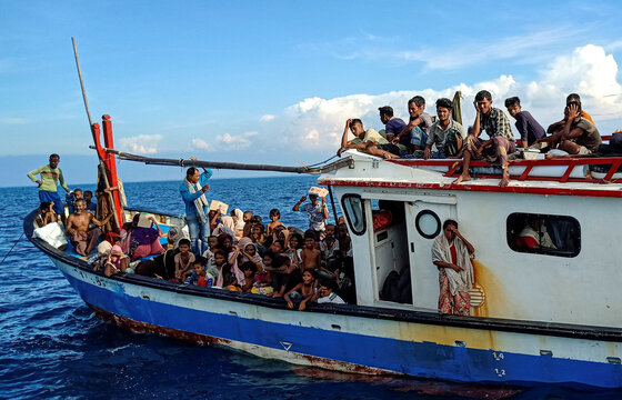Rohingya refugees are seen on a boat near the coast of Seunuddon beach in Aceh