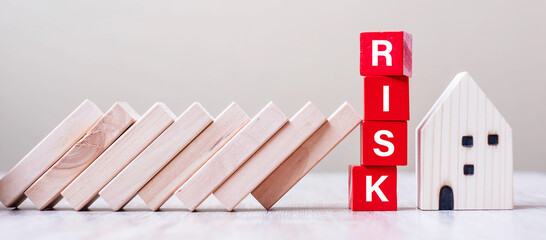 Red RISK cube blocks stop falling blocks protect house miniature. fall Business, Home Insurance, investment, Crisis, Economic recession, Developer, Real Estate and Property concept - fototapety na wymiar