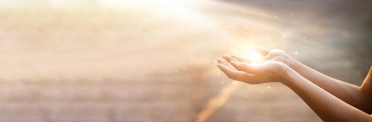 Fototapeta Woman hands praying for blessing from god on sunset background obraz