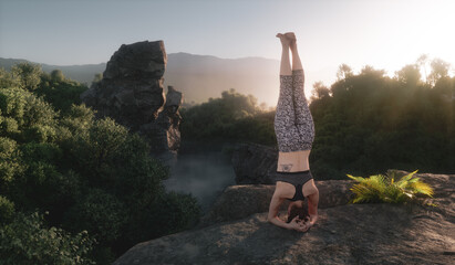 Young girl practising yoga sirsasana headstand on a high cliff edge in front of a beautiful forest wilderness scenery in warm evening sunset light. 3d rendering.