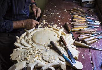 Senior man making a wood carving