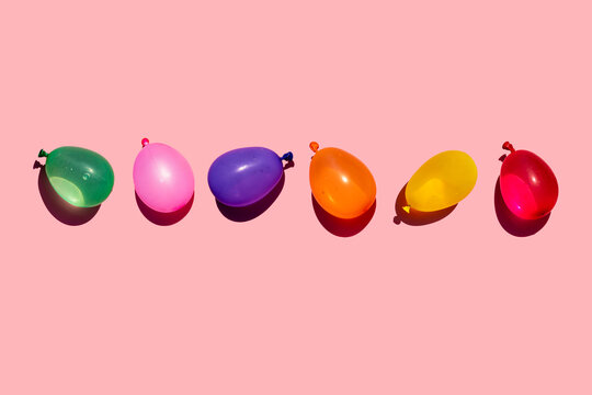 Studio shot of row of colorful water balloons