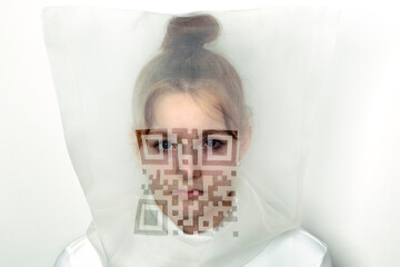 Portrait of teenage girl wearing  transparent mask with QR Code