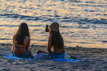 Teens Sitting at Sand in Mansa Beach, Punta del Este, Uruguay