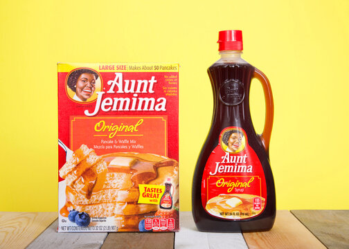 Alameda, CA - June 23, 2020: Aunt Jemima pancake mix next to a bottle of original syrup. The pancake mix debuted in 1889, the first ready mix, and became one of the most recognized names in US history
