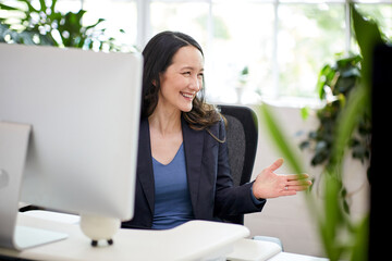 Professional business woman sitting at a desk with computer