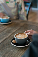 Image of a coffee on a wooden table