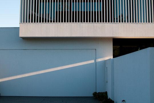 A ray of diagonal light beams across a modern house