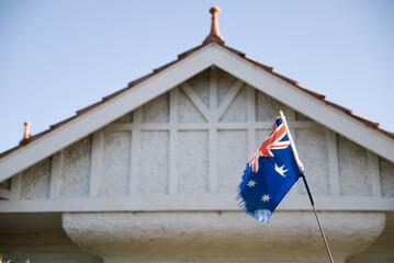 Torn Australian flag outside a house