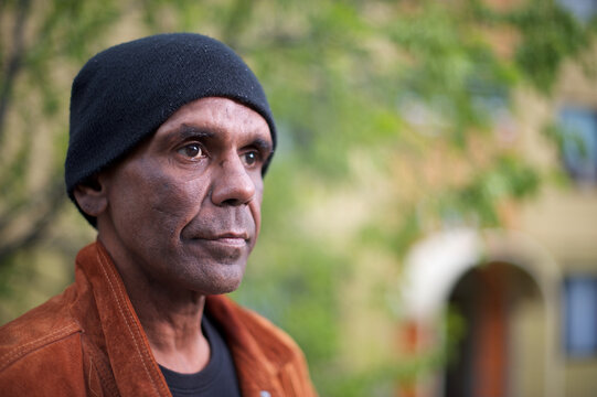 Aboriginal Man in his Forties, Tree in Background