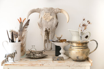 Fotorolgordijn Historisch mon. Bull Skull on the wall above a dresser top of collected natural objects