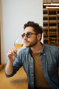 Man smelling fine wine